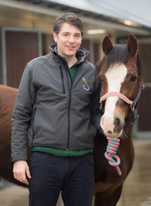 Tom Witte standing with a pony at Oaklands Veterinary Centre