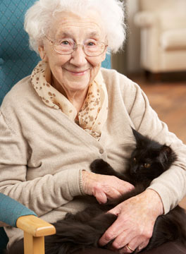 Ederly woman and cat